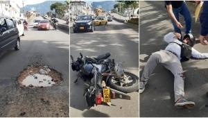 Vuelve y juega: hueco provocó accidente a motociclista en Ibagué