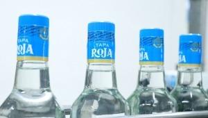Lanzan Aguardiente Tapa Roja con marcas de seguridad para combatir alcohol adulterado
